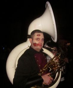 A zombie playing the sousaphone. I wanted one playing the trombone because of the tenuous trombone/bone/zombie connection. Ho hum.